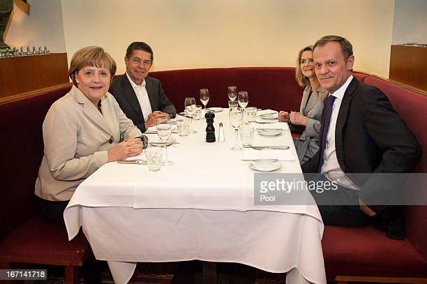 In this photo provided by the German Government Press Office German Chancellor Angela Merkel with her husband Joachim Sauer and Polish Prime Minister...