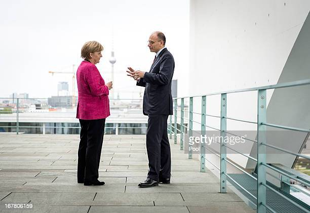 In this photo provided by the German Government Press Office German Chancellor Angela Merkel and Italy's new Prime Minister Enrico Letta in...