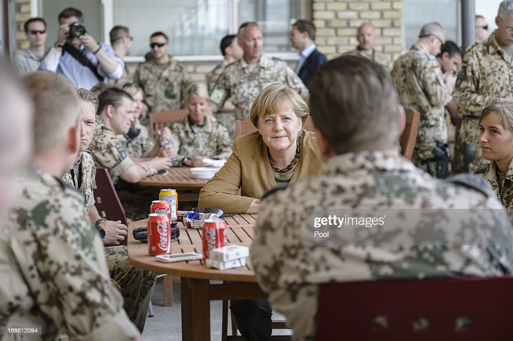 In this photo provided by the German Government Press Office (BPA), German Chancellor <a gi-track='captionPersonalityLinkClicked' href=/galleries/search?phrase=Angela+Merkel&family=editorial&specificpeople=202161 ng-click='$event.stopPropagation()'>Angela Merkel</a> talks to soldiers in a mess hall on May 10, 2013 in Mazar-e-Sharif, Afghanistan. Merkel visited German soldiers currently deployed and paid her respects to those who lost their lives during the conflict. A soldier of the German elite troop KSK died recently.