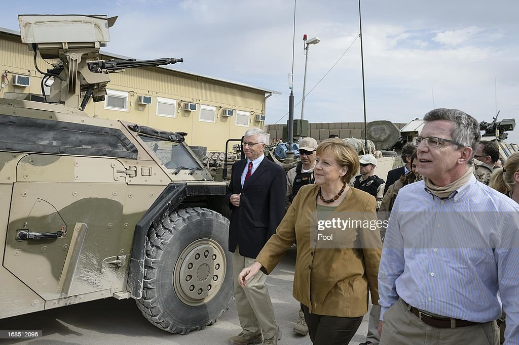 In this photo provided by the German Government Press Office (BPA), German Chancellor <a gi-track='captionPersonalityLinkClicked' href=/galleries/search?phrase=Angela+Merkel&family=editorial&specificpeople=202161 ng-click='$event.stopPropagation()'>Angela Merkel</a> talks to soldiers during a tour of the base on May 10, 2013 in Mazar-e-Sharif, Afghanistan. Merkel visited German soldiers currently deployed and paid her respects to those who lost their lives during the conflict. A soldier of the German elite troop KSK died recently.