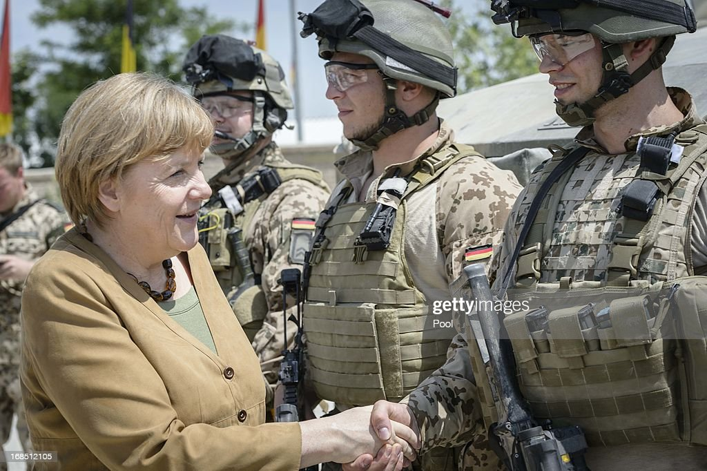 In this photo provided by the German Government Press Office (BPA), German Chancellor <a gi-track='captionPersonalityLinkClicked' href=/galleries/search?phrase=Angela+Merkel&family=editorial&specificpeople=202161 ng-click='$event.stopPropagation()'>Angela Merkel</a> speaks to German soldiers on May 10, 2013 in Kunduz, Afghanistan. Merkel visited German soldiers currently deployed and paid her respects to those who lost their lives during the conflict. A soldier of the German elite troop KSK died recently.