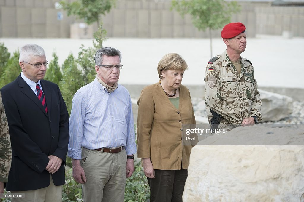 In this photo provided by the German Government Press Office (BPA), German Chancellor <a gi-track='captionPersonalityLinkClicked' href=/galleries/search?phrase=Angela+Merkel&family=editorial&specificpeople=202161 ng-click='$event.stopPropagation()'>Angela Merkel</a> takes part in a memorial service on May 10, 2013 in Kunduz, Afghanistan. Merkel visited German soldiers currently deployed and paid her respects to those who lost their lives during the conflict. A soldier of the German elite troop KSK died recently.