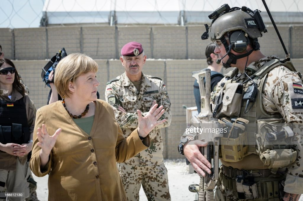 In this photo provided by the German Government Press Office (BPA), German Chancellor <a gi-track='captionPersonalityLinkClicked' href=/galleries/search?phrase=Angela+Merkel&family=editorial&specificpeople=202161 ng-click='$event.stopPropagation()'>Angela Merkel</a> talks to soldiers on May 10, 2013 in Kunduz, Afghanistan. Merkel visited German soldiers currently deployed and paid her respects to those who lost their lives during the conflict. A soldier of the German elite troop KSK died recently.