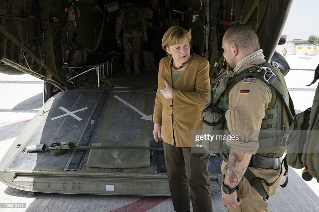 In this photo provided by the German Government Press Office (BPA), German Chancellor <a gi-track='captionPersonalityLinkClicked' href=/galleries/search?phrase=Angela+Merkel&family=editorial&specificpeople=202161 ng-click='$event.stopPropagation()'>Angela Merkel</a> talks to soldier after she arrived by helicopter on May 10, 2013 in Kunduz, Afghanistan. Merkel visited German soldiers currently deployed and paid her respects to those who lost their lives during the conflict. A soldier of the German elite troop KSK died recently.