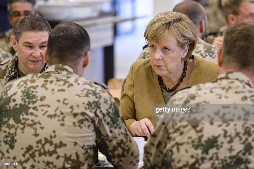 In this photo provided by the German Government Press Office (BPA), German Chancellor <a gi-track='captionPersonalityLinkClicked' href=/galleries/search?phrase=Angela+Merkel&family=editorial&specificpeople=202161 ng-click='$event.stopPropagation()'>Angela Merkel</a> talks to soldiers in the mess hall on May 10, 2013 in Kunduz, Afghanistan. Merkel visited German soldiers currently deployed and paid her respects to those who lost their lives during the conflict. A soldier of the German elite troop KSK died recently.