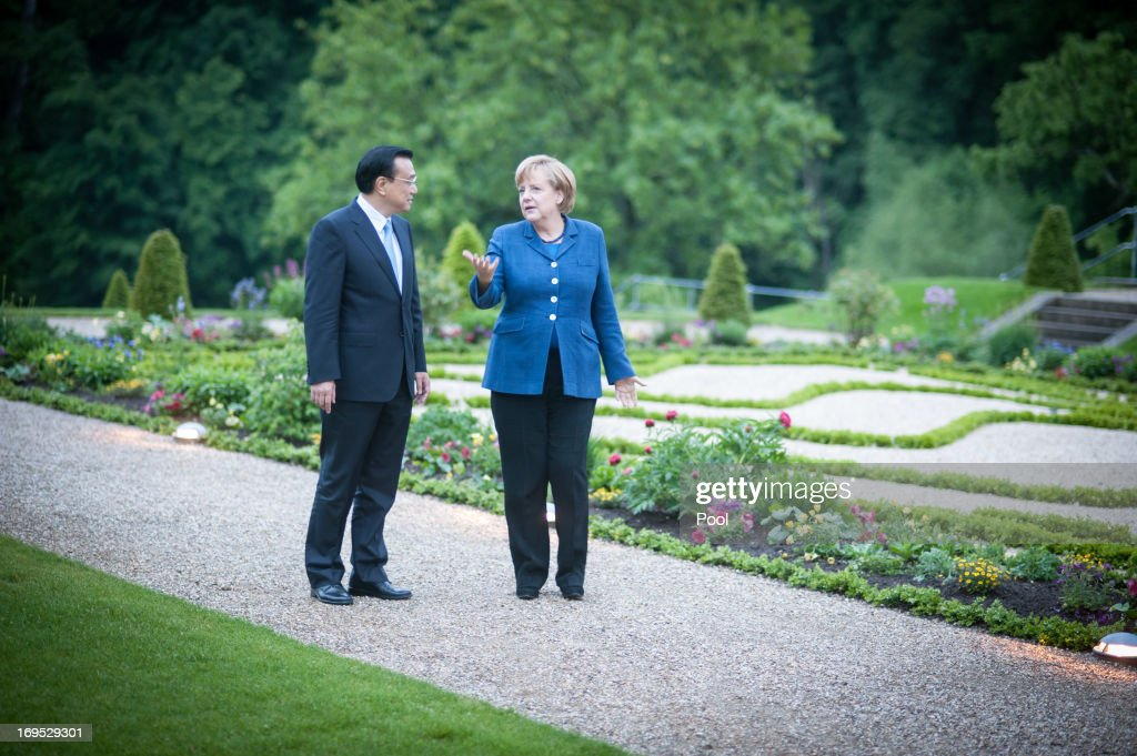 In this photo provided by the German Government Press Office (BPA), German Chancellor <a gi-track='captionPersonalityLinkClicked' href=/galleries/search?phrase=Angela+Merkel&family=editorial&specificpeople=202161 ng-click='$event.stopPropagation()'>Angela Merkel</a> and Chinese Prime Minister <a gi-track='captionPersonalityLinkClicked' href=/galleries/search?phrase=Li+Keqiang&family=editorial&specificpeople=2481781 ng-click='$event.stopPropagation()'>Li Keqiang</a> talk at the start of their meeting in the garden of Meseberg government guest house on May 26, 2013 in Meseberg, Germany. On his first official visit to Germany as prime minister Mr. Li is scheduled to meet with German government officials and business representatives.