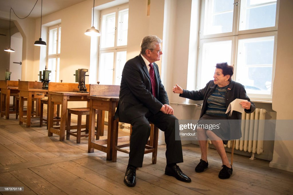 In this photo provided by the German Government Press Office (BPA), German President <a gi-track='captionPersonalityLinkClicked' href=/galleries/search?phrase=Joachim+Gauck&family=editorial&specificpeople=2077888 ng-click='$event.stopPropagation()'>Joachim Gauck</a> sits at a machine table as he talks with Inge Deutschkron (R), Chairwoman of the Blind Trust, in former workshops for the blind once owned by Otto Weidt, on November 8, 2013 in Berlin, Germany. Otto Weidt is renowned for his efforts to protect his Jewish workers, including Inge Deutschkron, from deportation during the Holocaust. Germany is commemorating the 75th anniversary of the Kristallnacht pogroms, during which Nazi gangs burned down synagogues, smashed shops and looted residences across Germany and Austria in a fury of anti-semitic violence in 1938. Persecution of Jews was a central component of Adolf Hitler's rise to power.
