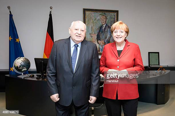 In this photo provided by the German Government Press Office German Chancellor Angela Merkel meets with former President of the Soviet Union Mikhail...