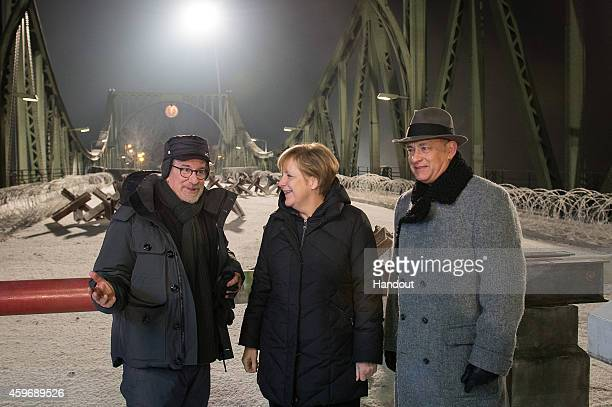 In this photo provided by the German Government Press Office German Chancellor Angela Merkel talks to director Steven Spielberg and actor Tom Hanks...