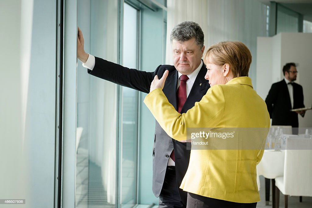 In this photo provided by the German Government Press Office (BPA), German Chancellor <a gi-track='captionPersonalityLinkClicked' href=/galleries/search?phrase=Angela+Merkel&family=editorial&specificpeople=202161 ng-click='$event.stopPropagation()'>Angela Merkel</a> talks with President of Ukraine <a gi-track='captionPersonalityLinkClicked' href=/galleries/search?phrase=Petro+Poroshenko&family=editorial&specificpeople=549382 ng-click='$event.stopPropagation()'>Petro Poroshenko</a> in the Chancellery on March 16, 2015 in in Berlin, Germany. Poroshenko was in Berlin for a meeting with German Chancellor <a gi-track='captionPersonalityLinkClicked' href=/galleries/search?phrase=Angela+Merkel&family=editorial&specificpeople=202161 ng-click='$event.stopPropagation()'>Angela Merkel</a> over the implementation of the Minsk ceasefire agreement as well as further reforms to help stabilize the troubled country. The conflict between Russian-backed separatists and government troops that began in Ukraine last year has claimed over 6,000 lives and displaced nearly 1.8 million people, according to the human rights office of the United Nations.