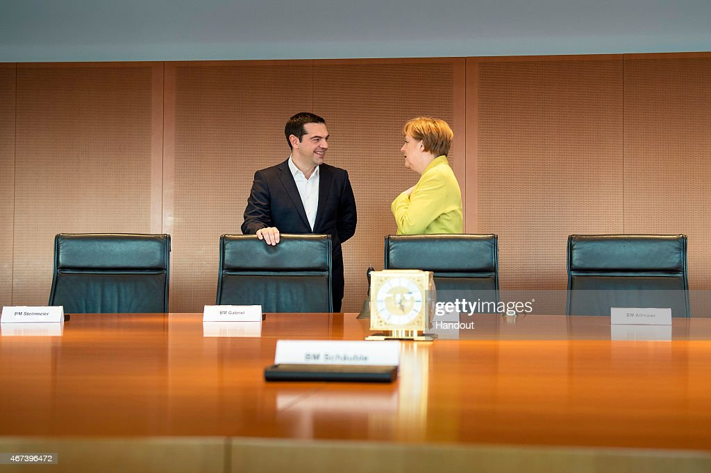 In this photo provided by the German Government Press Office (BPA), German Chancellor Angela Merkel and Greek Prime Minister Alexis Tsipras talk at the start of their meeting at the Chancellery on March 23, 2015 in in Berlin, Germany.
