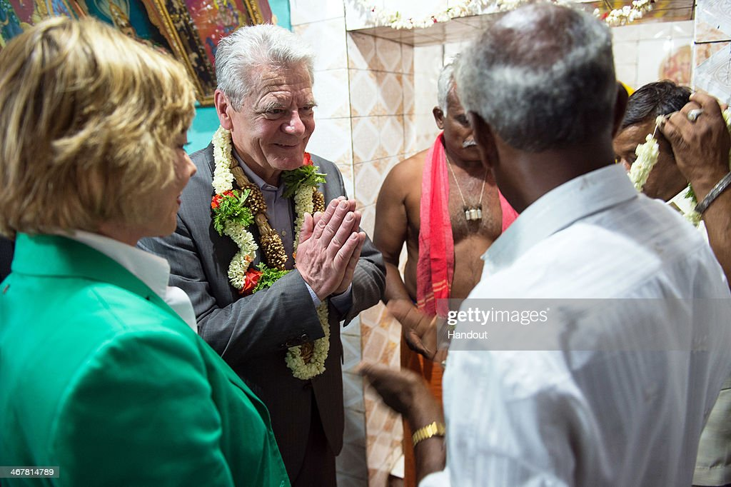 In this photo provided by the German Government Press Office (BPA), German President Joachim Gauck visits with partner Daniela Schadt (L) the temple in Muddapur after seeing a coconut fibre project on February 8, 2014 in Muddapur, India. Gauck is in India for an official six day visit.