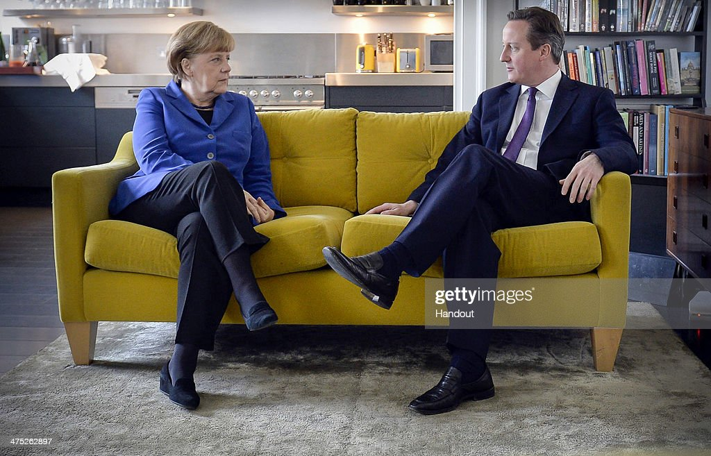 In this photo provided by the German Government Press Office German Chancellor Angela Merkel and British Prime Minister David Cameron chat at the...