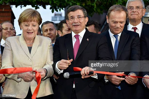 In this photo provided by the German Government Press Office German Chancellor Angela Merkel Turkey's Prime Minister Ahmet Davutoglu and President of...