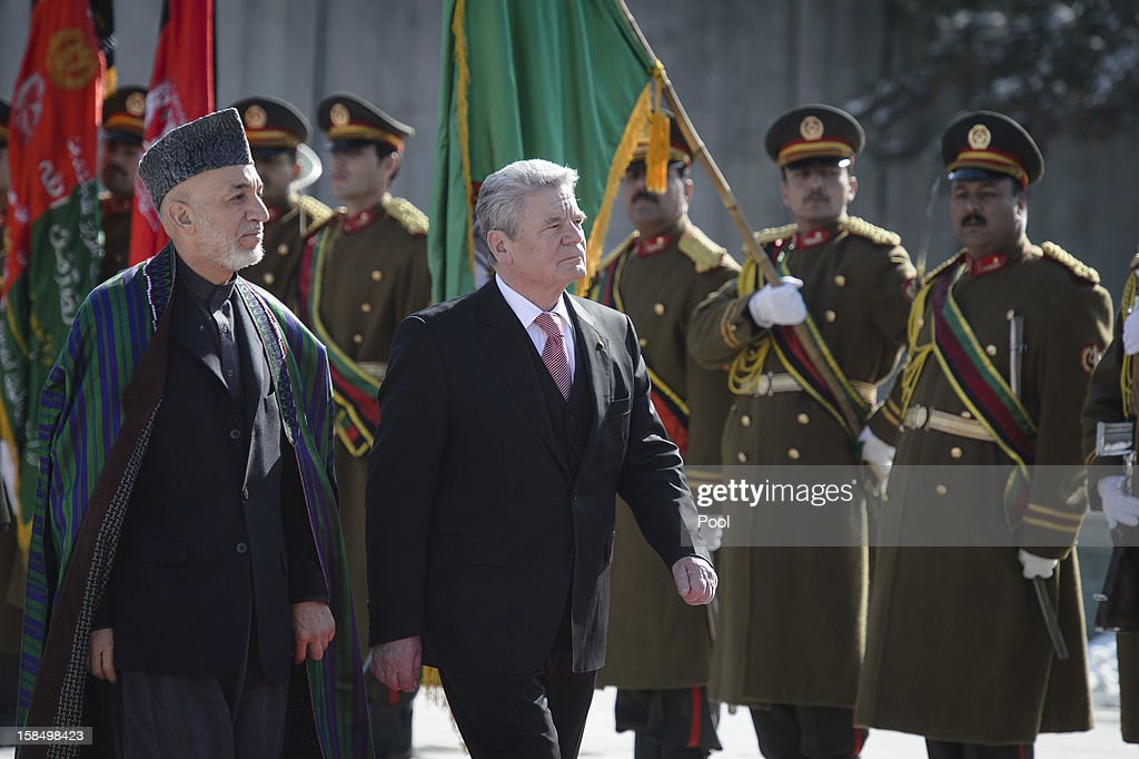 In this photo provided by the German Government Press Office Afghanistan President Hamid Karzai and German President Joachim Gauck review a guard of...