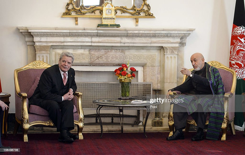 In this photo provided by the German Government Press Office (BPA), Afghanistan President <a gi-track='captionPersonalityLinkClicked' href=/galleries/search?phrase=Hamid+Karzai&family=editorial&specificpeople=121540 ng-click='$event.stopPropagation()'>Hamid Karzai</a> (R) and German President <a gi-track='captionPersonalityLinkClicked' href=/galleries/search?phrase=Joachim+Gauck&family=editorial&specificpeople=2077888 ng-click='$event.stopPropagation()'>Joachim Gauck</a> talk at the Presidential Palace on December 18, 2012 in Kabul, Afghanistan. The visit is Gauck's first to the region since taking office.