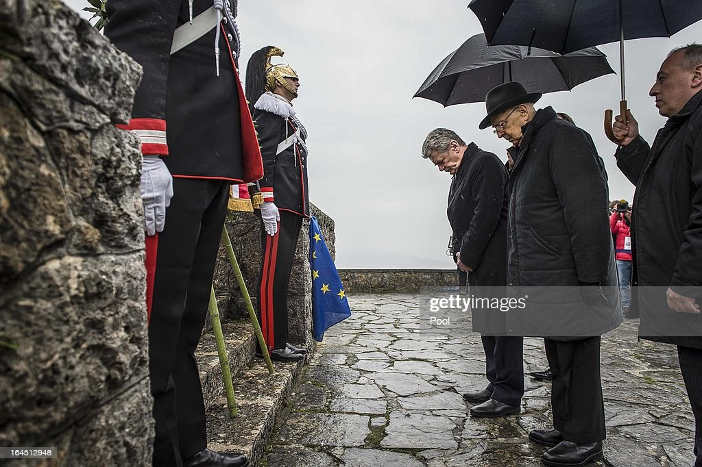 In this photo provided by the German Government Press Office (BPA), Italian President Giorgio Napolitano (R) and and his German counterpart Joachim Gauck pay their respects to the victims of the Sant'Anna Di Stazzema Nazi Massacre on March 24, 2013 in Sant'Anna di Stazzema, near Lucca, Italy. The heads of state paid homage to the 560 victims of the Nazi massacre which took place on August 12, 1944. The ceremony was also attended by survivors and relatives of the victims.