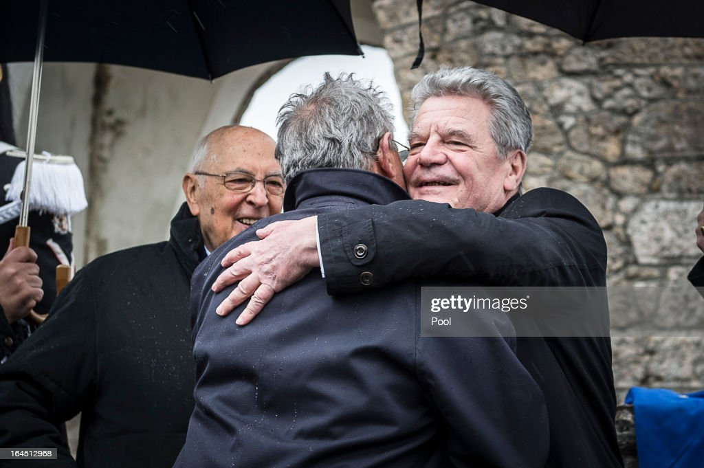 In this photo provided by the German Government Press Office (BPA), Italian President Giorgio Napolitano looks on as his German counterpart Joachim Gauck embraces massacre survivor Enrico Pieri on March 24, 2013 in Sant'Anna di Stazzema, near Lucca, Italy. The heads of state paid homage to the 560 victims of the Nazi massacre which took place on August 12, 1944. The ceremony was also attended by survivors and relatives of the victims.