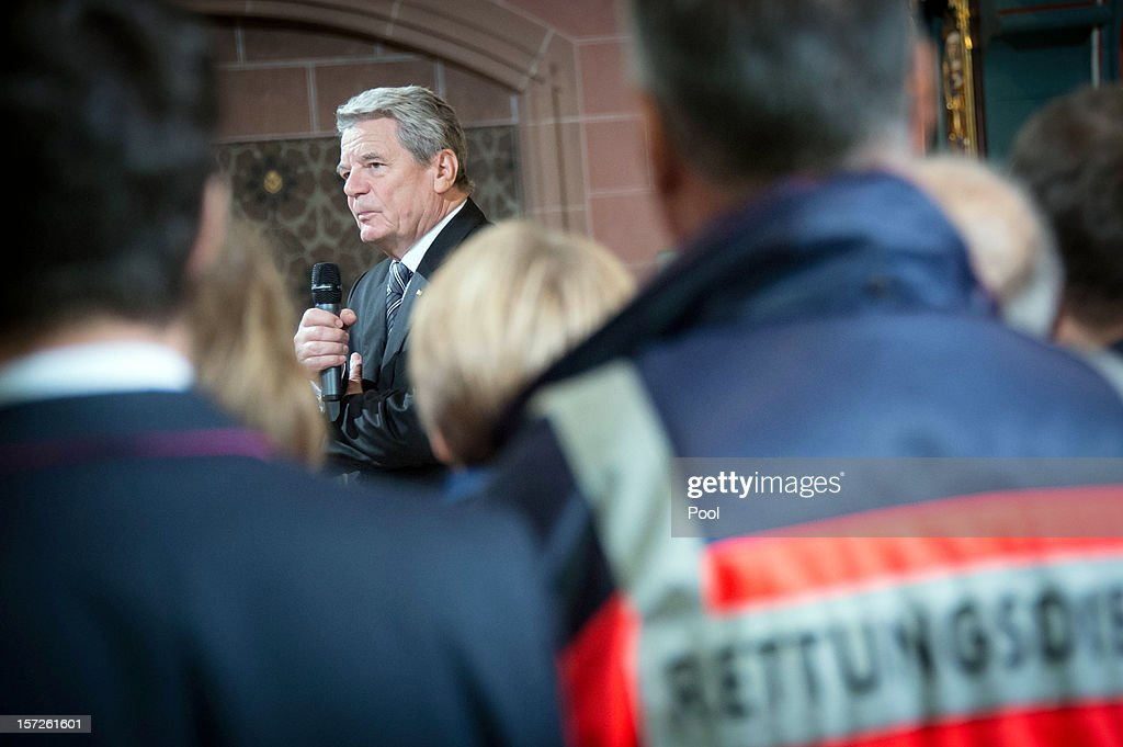 In this photo provided by the German Government Press Office (BPA), President Joachim Gauck talks to relatives and rescue workers at a memorial service for the victims of the fire disaster in the sheltered workshop, at Muenster St. Jakobus church on Decmber 01, 2012 in Titisee-Neustadt, Germany. An explosion triggerd by a gas leak caused the fire which claimed the lives of 14 people at a workshop for the disable in Germany's Black Forest region.