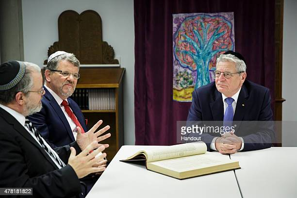 In this photo provided by the German Government Press Office Bundespresident Joachim Gauck meets Rabbi Shaul Friberg and the Rector Prof Dr Johannes...