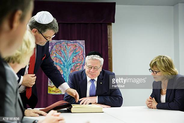 In this photo provided by the German Government Press Office Bundespresident Joachim Gauck and Daniela Schadt meet Rabbi Shaul Friberg and the Rector...