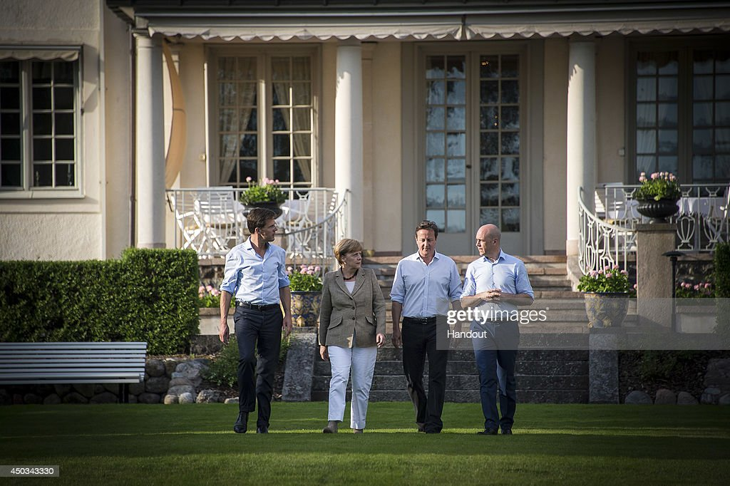 In this photo provided by the German Government Press Office (BPA), (L-R) Prime Minister of the Netherlands Mark Rutte, German Chancellor Angela Merkel, British Prime Minister David Cameron and Prime Minister of Sweden Fredrik Reinfeldt are seen during an informal meeting on June 9, 2014 in in Harpsund, Sweden. The Swedish Prime Minister will host the Prime Ministers of Germany, Britain and the Netherlands for talks on the EU and the new European Parliament from June 9 to 10.