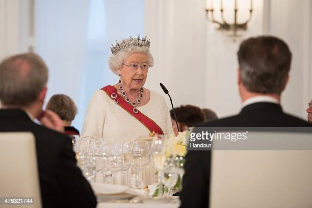 In this photo provided by the German Government Press Office Queen Elizabeth II gives a speech during a State Banquet at the Schloss Bellevue Palace...