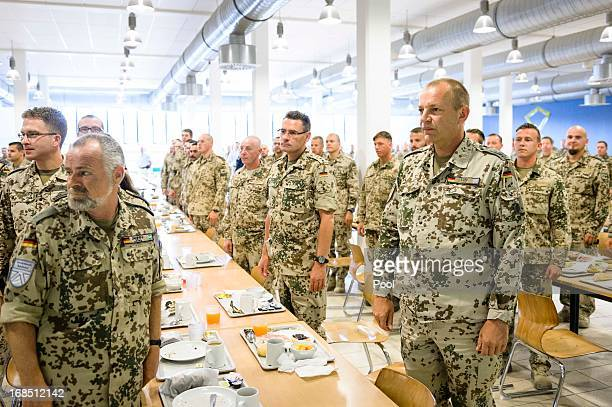 In this photo provided by the German Government Press Office soldiers stand to attention as German Chancellor Angela Merkel arrives in the mess hall...