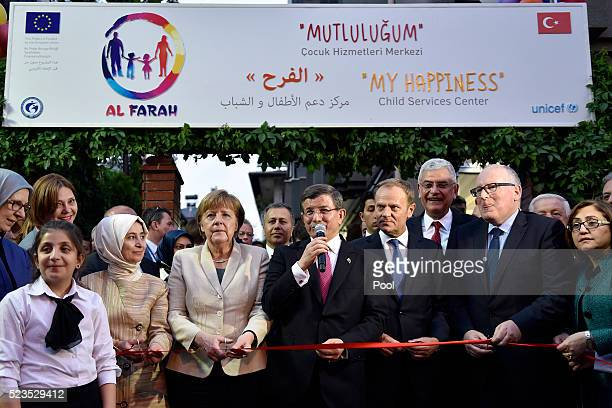 In this photo provided by the German Government Press Office Turkey's Prime Minister Ahmet Davutoglu speaks as President of the European Council...