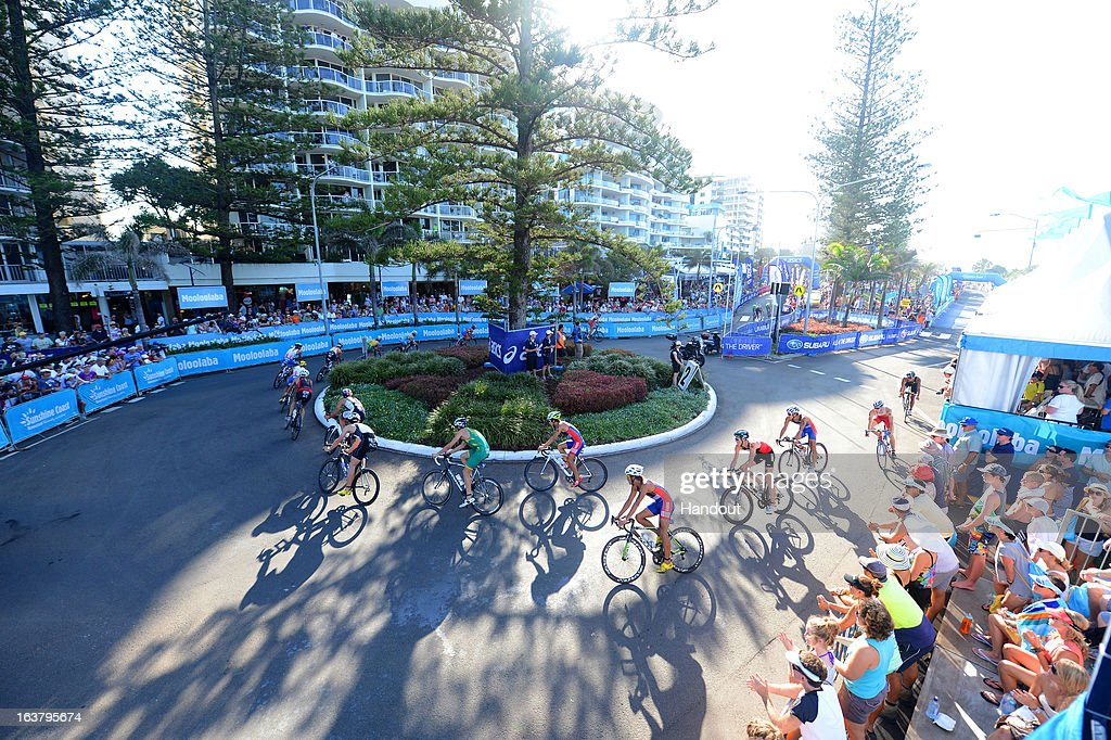 In this photo provided by the International Triathlon Union, Athletes in the elite men's race round a corner in front of spectators during the men's elite race at the 2013 Mooloolaba ITU Triathlon World Cup, his 13th World Cup title, on March 16, 2013 in Mooloolaba, Australia. (Photo by Delly Carr/ITU via Getty Images).