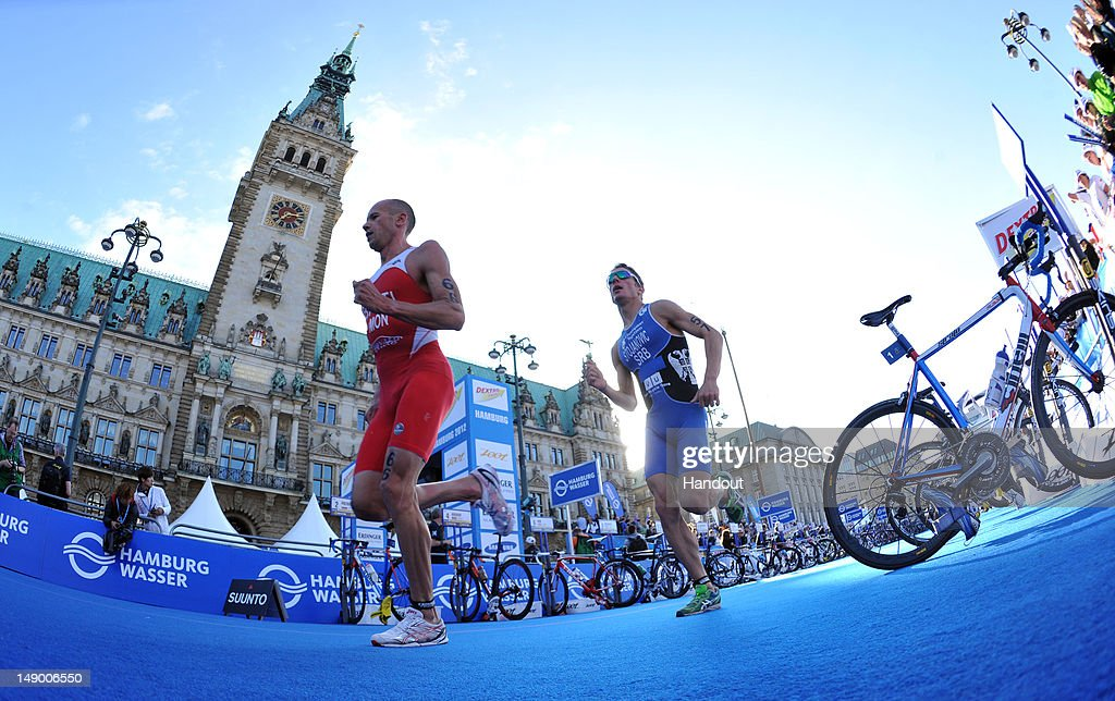 In this photo provided by the International Triathlon Union Monaco's Herve Banti and Serbia's Ognjen Stojanovic run past the Hamburg Rathaus at the...