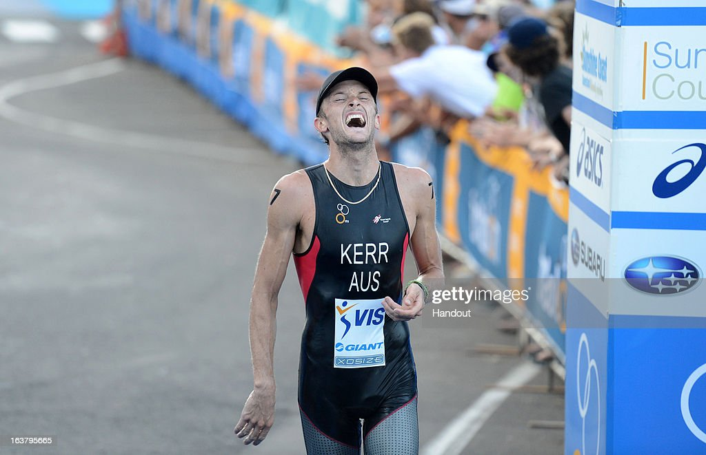 In this photo provided by the International Triathlon Union, Peter Kerr of Australia celebrates taking bronze during the men's elite race at the 2013 Mooloolaba ITU Triathlon World Cup on March 16, 2013 in Mooloolaba, Australia. (Photo by Delly Carr/ITU via Getty Images).