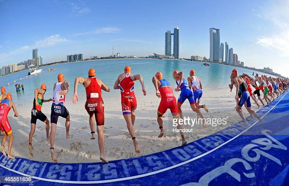 In this photo provided by the International Triathlon Union the elite men's starts during the 2015 International Triathlon on March 7 2015 in Abu...