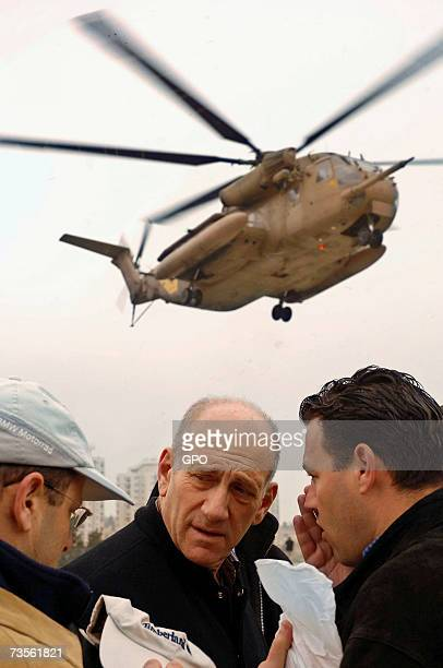 In this photo provided by the Israeli Government Press Office Israeli Prime Minister Ehud Olmert is seen soon after landing for a briefing on the...