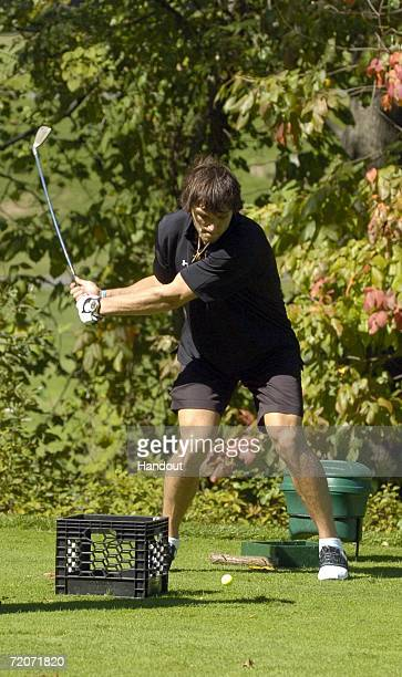 In this photo provided by the National Hockey League Alex Ovechkin of the Washington Capitals hits balls on the fourth hole at the Springfield Golf...