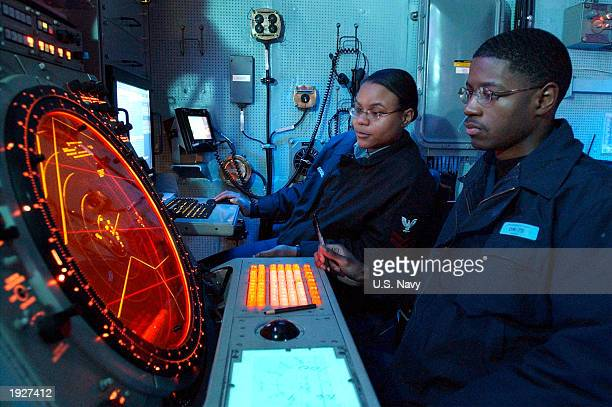 In this photo provided by the US Navy air traffic controllers aboard the USS Harry S Truman monitor aircraft departures in the Carrier Control...