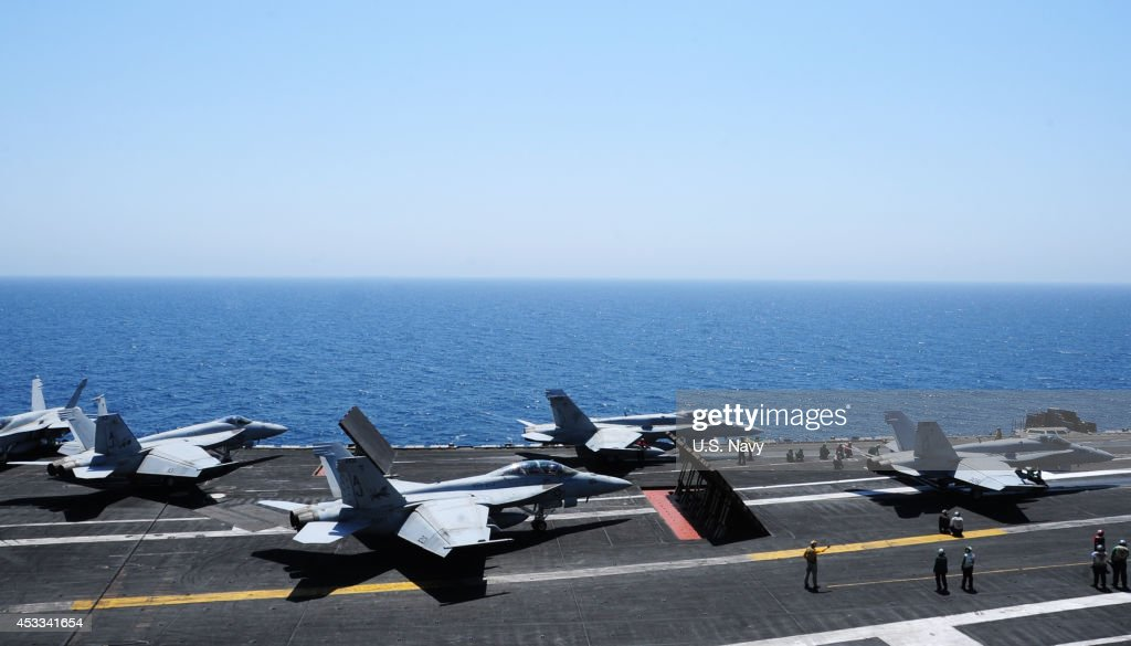 In this photo provided by the U.S. Navy, aircraft launch from the flight deck of the the aircraft carrier USS George H.W. Bush (CVN 77) on August 7, 2014 in the Arabian Gulf. The George H.W. Bush is supporting maritime security operations and theater security cooperation efforts in the U.S. 5th Fleet area of responsibility.