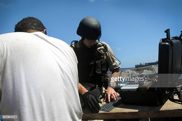 In this photo provided by the US Navy Electronics Technician 2nd Class Erik Holmberg a member of the visit board search and seizure team from the...