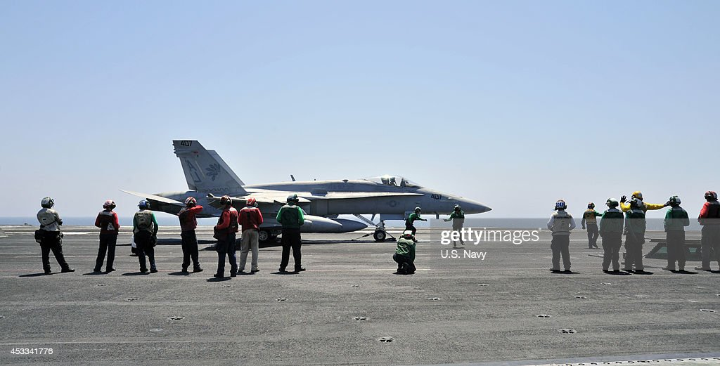 In this photo provided by the U.S. Navy, Final inspections are made on an F/A-18C Hornet assigned to the Golden Warriors of Strike Fighter Squadron (VFA) 87 aboard the aircraft carrier USS George H.W. Bush (CVN 77) on August 7, 2014 in the Arabian Gulf. The George H.W. Bush is supporting maritime security operations and theater security cooperation efforts in the U.S. 5th Fleet area of responsibility.