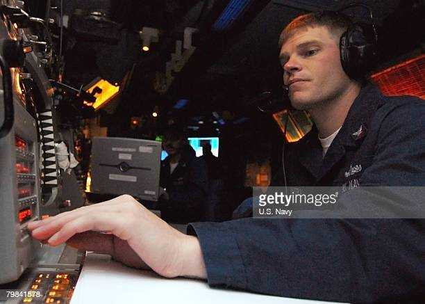 In this photo provided by the US Navy Fire Controlman 2nd Class John Whitby from San Leandro CA operates the radar system control in the combat...
