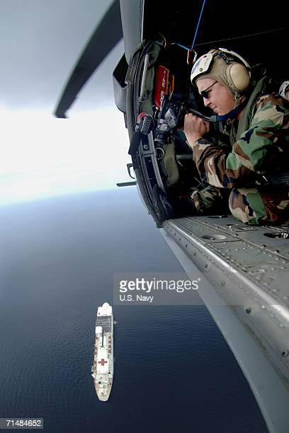 In this photo provided by the US Navy Mass Communications Specialist 2nd Class Gregory E Badger videotapes the US Naval hospital ship USNS Mercy July...