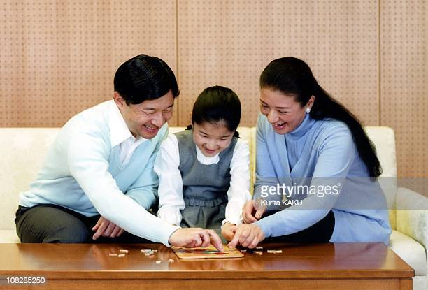 In this photo released by the Imperial Household Agency Crown Prince Naruhito Crown Princess Masako and their daughter Princess Aiko play a game...