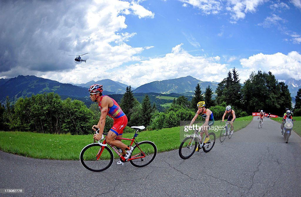 In this photo released by the International Triathlon Union, elite men including Javier Gomez of Spain climb Kitzbuehler Horn during the 2013 International Triathlon Union World Triathlon Series July 6, 2013 in Kitzbuehel, Austria.