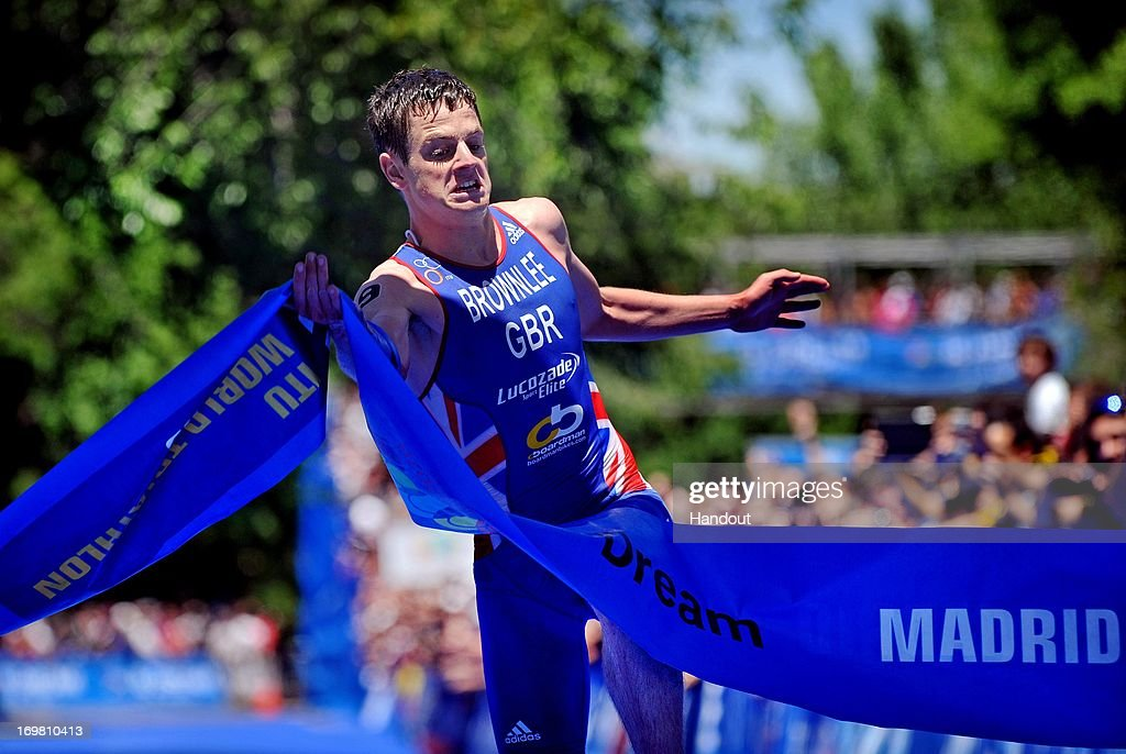 In this photo released by the International Triathlon Union, Great Britain's <a gi-track='captionPersonalityLinkClicked' href=/galleries/search?phrase=Jonathan+Brownlee&family=editorial&specificpeople=5426331 ng-click='$event.stopPropagation()'>Jonathan Brownlee</a> secures his second consecutive World Triathlon Series (WTS) win, as well as second win in Madrid in as many years on June 2, 2013 in Madrid, Spain.