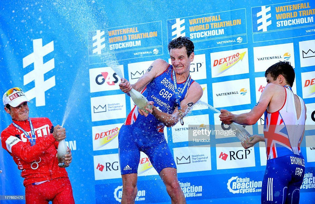In this photo released by the International Triathlon Union, Great Britain's Alistair Brownlee and Jonathan Brownlee, as well as Spain's Javier Gomez celebrate their podium finishes with champage at the ITU World Triathlon Stockholm on August 25, 2013 in Stockholm, Sweden.