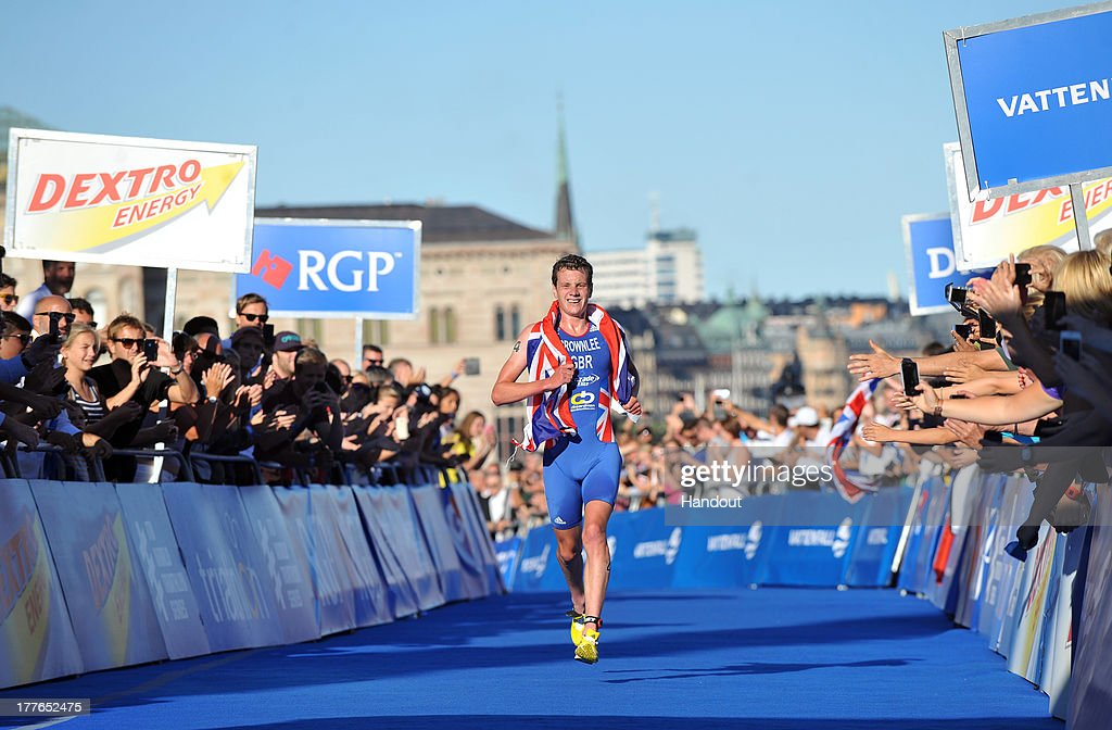 In this photo released by the International Triathlon Union, Great Britain's Alistair Brownlee runs to the win and clenches the series leader position ahead of the Grand Final at the ITU World Triathlon Stockholm on August 25, 2013 in Stockholm, Sweden.