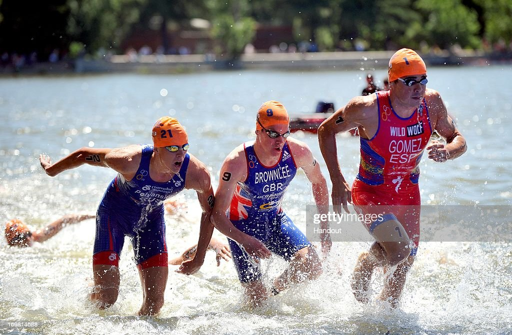 In this photo released by the International Triathlon Union, Javier Gomez and Ivan Vasiliev exit the water en route to claiming silver and bronze at the ITU World Triathlon Madrid on June 2, 2013 in Madrid, Spain.