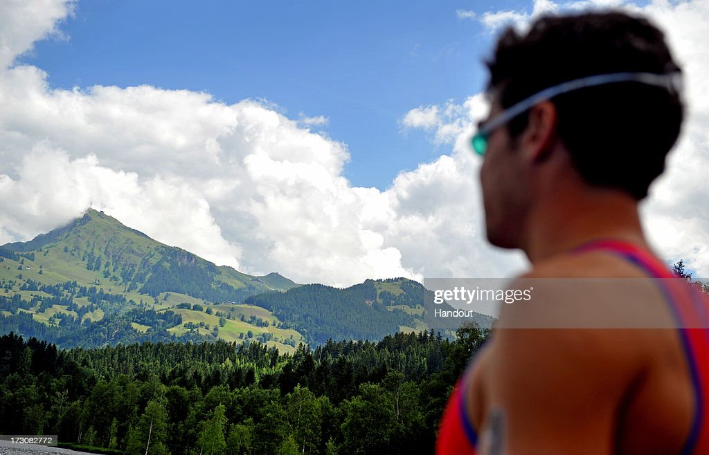 In this photo released by the International Triathlon Union, Javier Gomez of Spain looks at the mountain he will climb before starting the 2013 International Triathlon Union World Triathlon Series July 6, 2013 in Kitzbuehel, Austria.