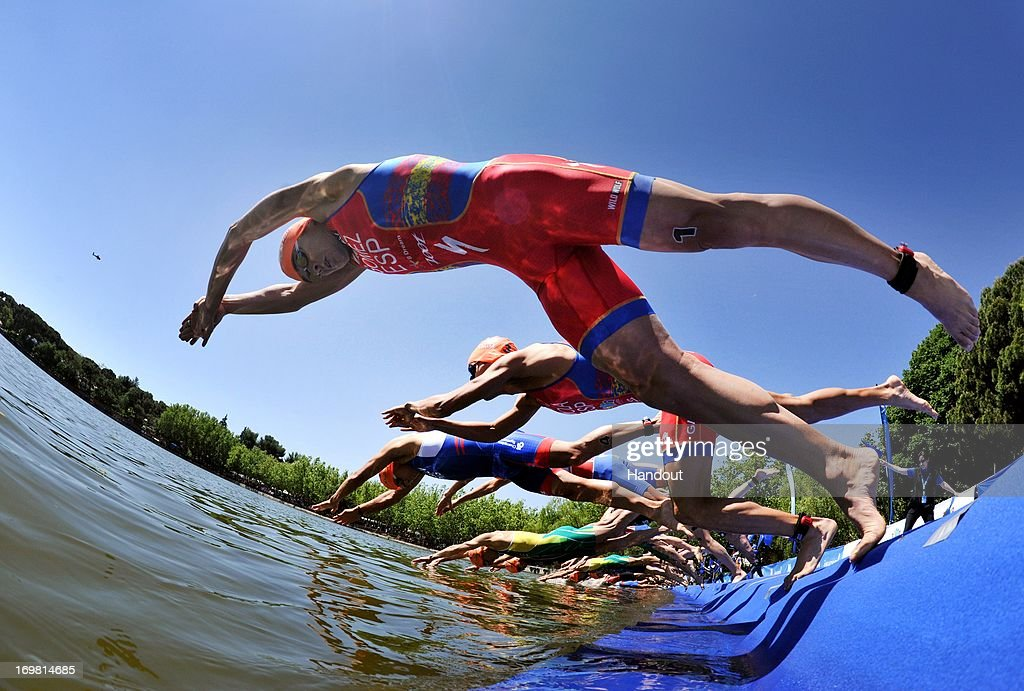 In this photo released by the International Triathlon Union, Spain's Javier Gomez and the men's elite race dive in at Casa de Campo at the ITU World Triathlon Madrid on June 2, 2013 in Madrid, Spain.