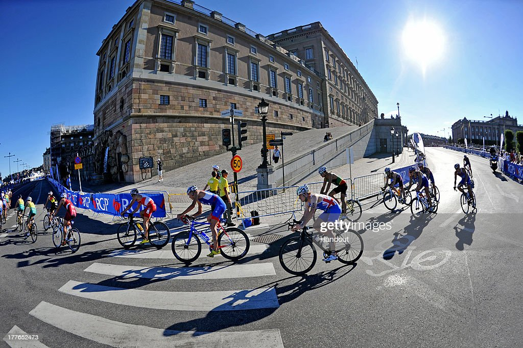 In this photo released by the International Triathlon Union, the elite men bike around the Royal Palace at the ITU World Triathlon Stockholm on August 25, 2013 in Stockholm, Sweden.